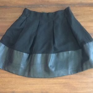 Black mini skirt with faux leather trim